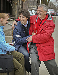 April 18, 2011 - Toronto, Ontario, Canada - April 18 2011- Lui Temkovski (in Red) the Liberal candidate for Oak Ridges-Markham jokes with  Justin Trudeau by sitting on his lap during an interview. Trudeau was on his Liberal Party's auxiliary tour around the GTA today.  They go mainstreeting in the town of Markham. DAVID COOPER / TORONTO STAR)dac (Credit Image: © David Cooper/The Toronto Star via ZUMA Wire)