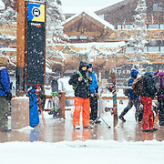 Skiers wait for the bus at the end of the day at Teton Village.