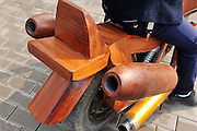 SHANGRAO, CHINA - FEBRUARY 09: (CHINA OUT) <br /> <br /> Homemade Wooden Motorcycle<br /> <br /> Woodcutter Yu Jietao shows his homemade wooden motorcycle on the street in Guangfeng County on February 9, 2015 in Shangrao, Jiangxi province of China. Chinese woodcutter Yu Jietao spent more than a month to make wooden motorcycle ahead of the upcoming Chinese Lunar New Year. The wooden motor vehicle was in 2.7 meters long, 1.25 meters high and 0.9 meters wide and costed totally about 20,000 (3,204 USD). More interesting, the facade of the motor vehicle was made of Burmese rosewood and the two pipes back the vehicle could spray barrages.<br /> ©Exclusivepix Media
