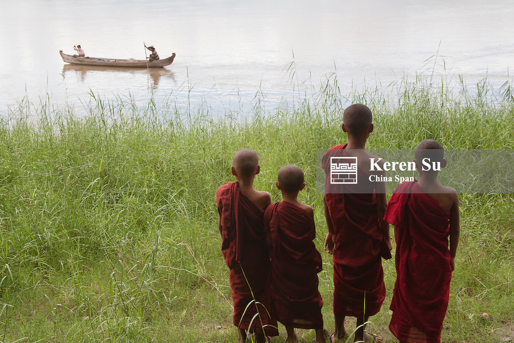 Four novice monks by Irrawaddy River, Bagan, Myanmar