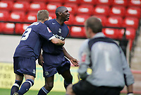 Photo: Paul Thomas.<br /> Walsall v Southend. Coca Cola League 1.<br /> 13/08/2005.<br /> <br /> Bart Griemink celebrates with Shaun Goater after he levels the scores.