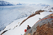 Dr. Tad Pfeffer, a glaciologist with the University of Colorado, rappels off a cliff to service an Extreme Ice Survey timelapse camera overlooking the Columbia Glacier, near Valdez, Alaska.