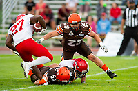 KELOWNA, BC - AUGUST 17:  Cory MCCOY #54 and Brenden RIPCO #29 of Okanagan Sun tackle Zachary Lubin #27 of Westshore Rebels  at the Apple Bowl on August 17, 2019 in Kelowna, Canada. (Photo by Marissa Baecker/Shoot the Breeze)