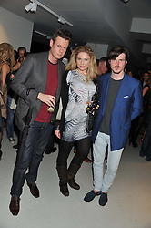 Left to right, PERCY PARKER, IRRA KHI and ANTOIN COMMANE at Diego Bivero-Volpe's 30th birthday party in aid of the charity Kids Company held at the Rook & Raven Gallery, 7 Rathbone Place, London W1 on 12th April 2013.