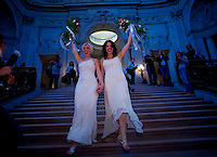 Amber Weiss, 31, and Sharon Papo, 29, walk down the stairs of San Francisco City Hall after they were married, on the second day of legal gay marriages in California, Tuesday June 17, 2008.