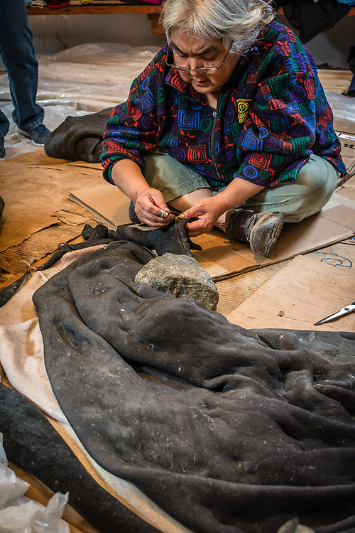 The sewing of a seal skin.