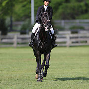 Beezie Madden riding Cortes 'C' in action during the $100,000 Empire State Grand Prix presented by the Kincade Group during the Old Salem Farm Spring Horse Show, North Salem, New York,  USA. 17th May 2015. Photo Tim Clayton