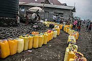 Residents lined up their water containers to the water stand in Katoyi, the outskirt of Goma. The water stands did not provide water for three days as the main pipe that runs from the Munigi reservoir to the neighborhoods of Majengo and Katoyi. People would walk to the Kivu Lake for one hour or bought water from the water sellers for 200 Congolese Franc per 20 Liters.