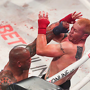 HOLLYWOOD, FL - JUNE 26: Hector Lombard hits Joe Riggs in the eye, causing a stoppage of the fight during the Bare Knuckle Fighting Championships at the Seminole Hard Rock & Casino on June 26, 2021 in Hollywood, Florida. (Photo by Alex Menendez/Getty Images) *** Local Caption *** Hector Lombard; Joe Riggs