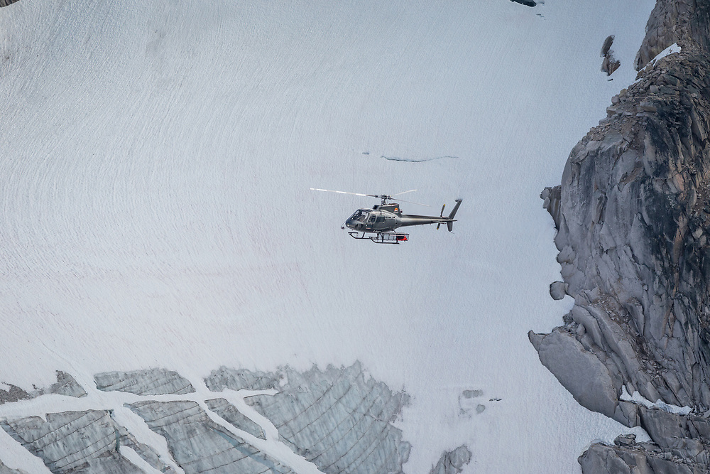 Dirk flying in the Bugaboos enroute to East Creek - Whitetooth Helicopters