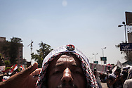 Arrested Egyptian president Morsi on a badge worn by a pro-government demonstrator in Cairo.