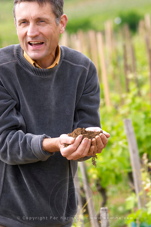 Alberic Mazoyer showing soil in his hands owner dom a voge cornas rhone france