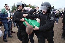 June 12, 2017 - St. Petersburg, Russia - Russian police officers detain a participant of an unauthorized opposition rally.  About 10 thousand people participated in the protest with 500  detained. (Credit Image: © Valya Egorshin/NurPhoto via ZUMA Press)