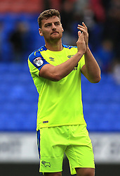 Derby County's Chris Martin applauds the travelling support