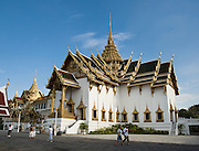 The cruciform (cross shaped) Dusit Maha Prasat throne hall in Bangkok, Thailand, was built by King Rama I in 1790. Ever since then, this hall has hosted the lying-in-state of kings, queens and honored members of the royal family.  It also supports the annual Coronation Day ceremony. Panorama stitched from 2 overlapping photos.