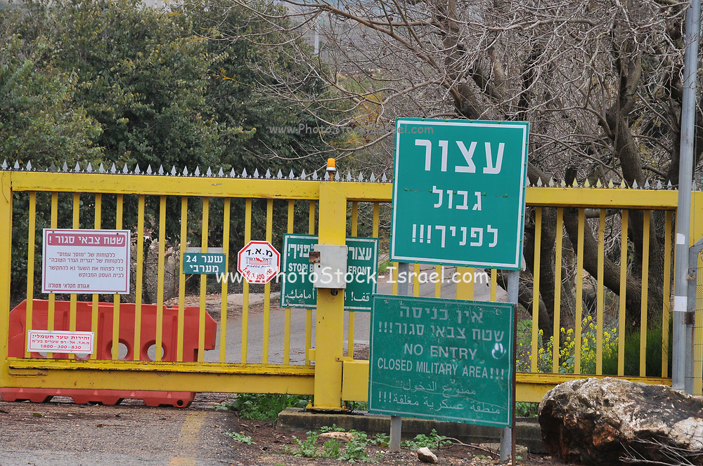 Israel, Upper Galilee the Good fence border crossing between Israel and Lebanon near Metula a sign reading Stop Border in front of you in English, Hebrew and arabic