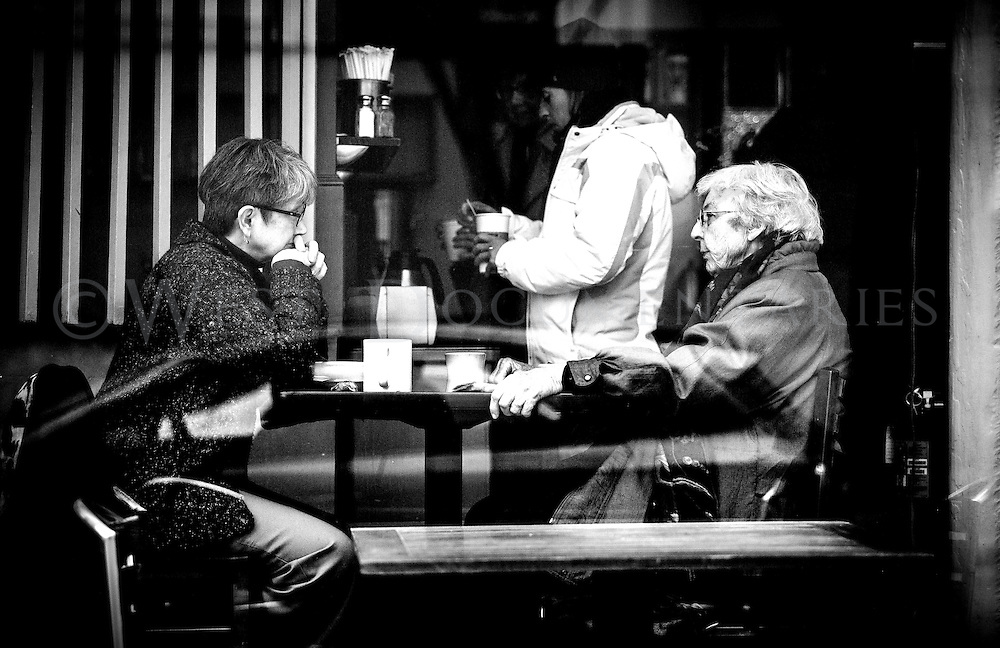 A mother and daughter, who sat staring at each other over their drinks at a window-side table during an early morning visit to the Morning Times coffee shop on April 7, 2015.