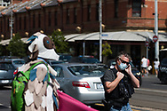 A native Australian bird protests as a police officer walks by during an Extinction Rebellion protest in Melbourne.  A small group of climate protesters marched from Flagstaff Gardens to The Queen Victoria Market and ending with two individuals gluing themselves together, and then glued themselves to Victoria Avenue outside of the Market. This comes as 5 new COVID-19 cases were uncovered in Melbourne's revamped Hotel Quarantine, breaking almost 40 days of virus free days. (Photo by Dave Hewison/Speed Media)
