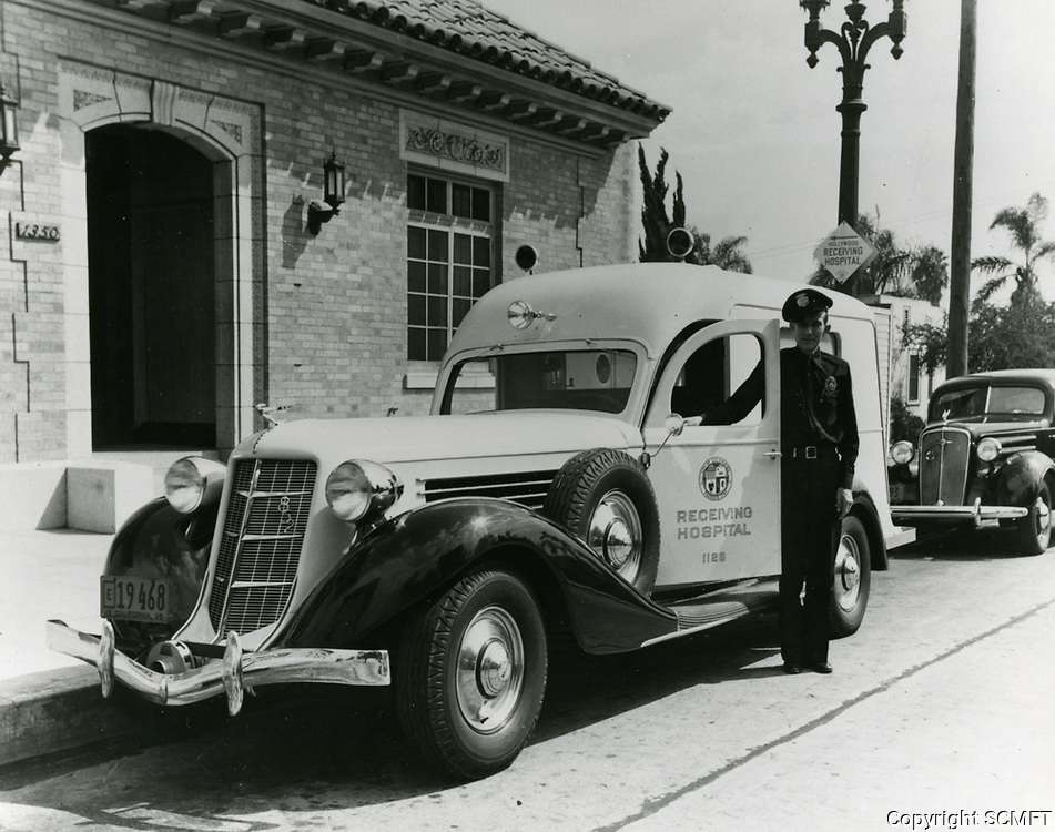 1936 Ambulance driver at the emergency receiving hospital on Wilcox. Ave