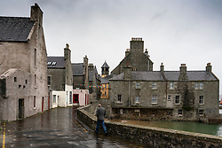 Man walking on Commercial Street in old town in Lerwick, Shetland , Scotland, UK