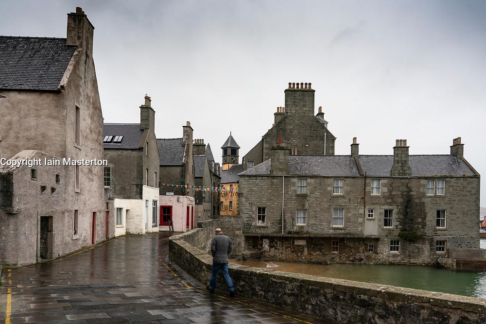 Man walking on Commercial Street in old town in Lerwick, Shetland , Scotland, UK