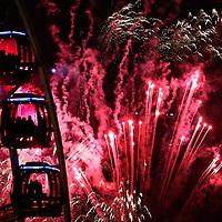 Fireworks over Edinburgh to celebrate the New Year's Eve Edinburgh Hogmanay street party, Scotland.