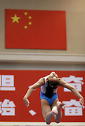 A Girl on China's national gymnastics team works out her balance beam routine during training in Beijing. China has ordered its national gymnasts to turn in their computers and car keys, turn off their cell phones at 10 p.m. and stay in at night, so they will be fresh for training the next day.