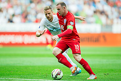 Ales Mertelj of Slovenia vs Wayne Rooney of England during the EURO 2016 Qualifier Group E match between Slovenia and England at SRC Stozice on June 14, 2015 in Ljubljana, Slovenia. Photo by Vid Ponikvar / Sportida