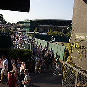 Spectators move along the walkways between the courts at the All England Lawn Tennis Championships at Wimbledon, London, England on Tuesday, June 30, 2009. Photo Tim Clayton.