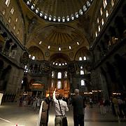 Visiting tourists wathing Ayasofia dome