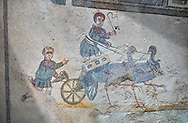 Close up picture of the Roman mosaics of the room of the Small Circus depicting Roman boys riding small chariots pulled by birds in a small circus, The Vestibule of The Smnall Circus, room no 41  at the Villa Romana del Casale, first quarter of the 4th century AD. Sicily, Italy. A UNESCO World Heritage Site.<br /> <br /> The Roman mosaic know as the Small Circus at the Villa Romana del Casale depicts a scene of a chariot race from the Circus Maximus in Rome. Two wheeled chariots, driven by children,  are racing around a central Pina (barrier) being drawn by fowl and web footed birds. The four chariots represent the four factions that raced against each other at the Circus and the tunics of the cild charioteers and the birds pulling their chariots are distinguished by the four different colours used by each faction. .<br /> <br /> If you prefer to buy from our ALAMY PHOTO LIBRARY  Collection visit : https://www.alamy.com/portfolio/paul-williams-funkystock/villaromanadelcasale.html<br /> Visit our ROMAN MOSAICS  PHOTO COLLECTIONS for more photos to buy as buy as wall art prints https://funkystock.photoshelter.com/gallery/Roman-Mosaics-Roman-Mosaic-Pictures-Photos-and-Images-Fotos/G00008dLtP71H_yc/C0000q_tZnliJD08