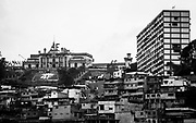 """View of the 4th February Military barracks, 15th March 2013, on the Barrio of 23 Enero in Caracas, where Venezuela's President, Hugo Chávez, remains rest.  The 4F Military headquartes, it's where Hugo Chávez commanded his fail coup in 1992 and it was turned into a museum in memory of the late President. Chávez ruled Venezuela for 14 years, passed away on the 5th March 2013.  He revolutionized not only his nation but also other countries in Latin America, with his political views and what he called the """"21st Century Socialism"""", supported by the petrodollars from Venezuela's massive oil-reserves."""