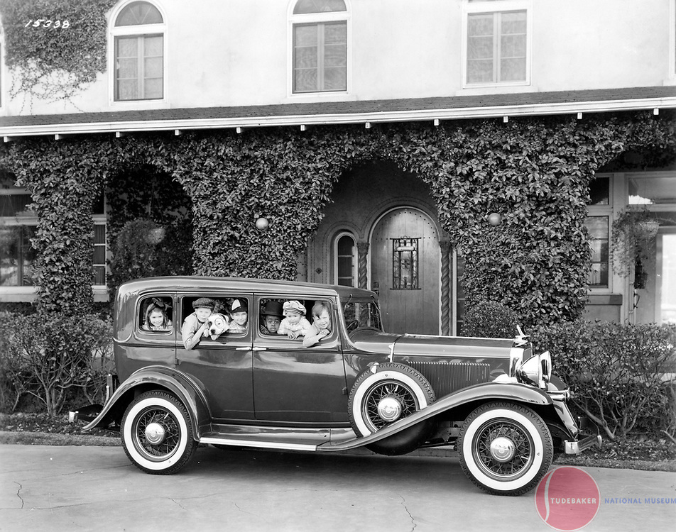 """Stars of the """"Our Gang"""" comedy shorts pose with a 1932 Studebaker Commander sedan."""
