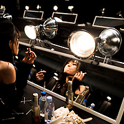 Model Sora Choy applies lipstick at the end of the Coach show in Manhattan, New York on Tuesday, September 11, 2018. John Taggart for The New York Times