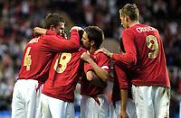 Photo: Richard Lane.<br />England 'B' v Belarus. International Friendly. 25/05/2006.<br />England's Michael Owen (C) congratulates scorer Jermaine Jenas.
