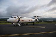 A man exits an Air Niugini Fokker 100 plane after landing at Wewak airport inPapua New Guinea.