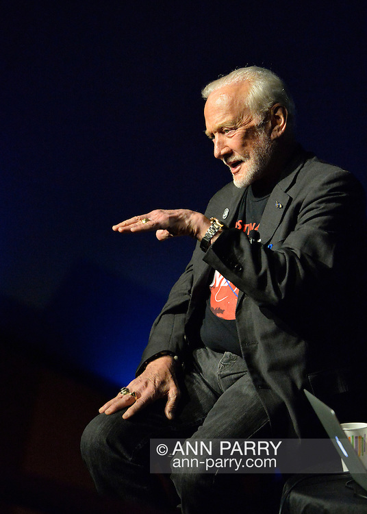 Garden City, New York, USA. October 23, 2015. Former NASA astronaut Edwin BUZZ ALDRIN gestures with his left hand out flat during conversation about his early years,  experiences in space, and his new Children's Middle Grade book Welcome to Mars: Making a Home on the Red Planet. After the talk at the jetBlue Sky Theater Planetarium at Long Island's Cradle of Aviation Museum, Aldrin signed copies of his new book. On the 1969 Apollo 11 mission, Buzz Aldrin was the second person ever to walk on the Moon, and his first trip to space was the 1966 Gemini 12.