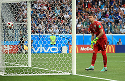 Uruguay goalkeeper Fernando Muslera looks dejected after letting the ball into his net as France score their second goal of the game