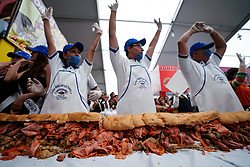 "(170727) -- MEXICO CITY, July 27, 2017 (Xinhua) -- People take part in the elaboration of a giant Mexican traditional sandwich named ""Torta"" during the ""Torta Fair"" in Mexico City, capital of Mexico, July 26, 2017. According to local press, during the event which is held from July 26 to 30, people made a ""torta"" of 67 meters long and 820 kilograms in weight, trying to break the world record of the largest torta. (Xinhua/Francisco Canedo) (zy) (Photo by Xinhua/Sipa USA)"