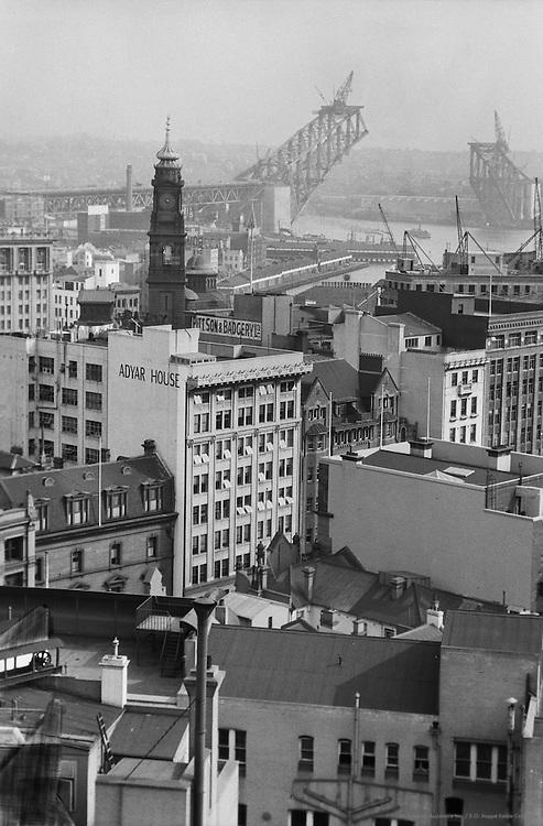 A glimpse of the new bridge & part of the harbour, Sydney, Australia, 1930