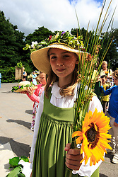 © Licensed to London News Pictures. 11/07/2015. Grasmere, UK. Residents of Grasmere take part in the . Rushbearing festival. Rushbearing is an old English ecclesiastical festival in which rushes are collected and carried to be strewn on the floor of the parish church. <br />