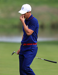 Team Europe's Thorbjorn Olesen reacts on the thirteenth green during the Fourballs match on day one of the Ryder Cup at Le Golf National, Saint-Quentin-en-Yvelines, Paris.