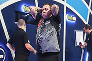 Kim Huybrechts wins his first round match against Geert Nentjes and celebrates during the PDC William Hill Darts World Championship at Alexandra Palace, London, United Kingdom on 13 December 2019.
