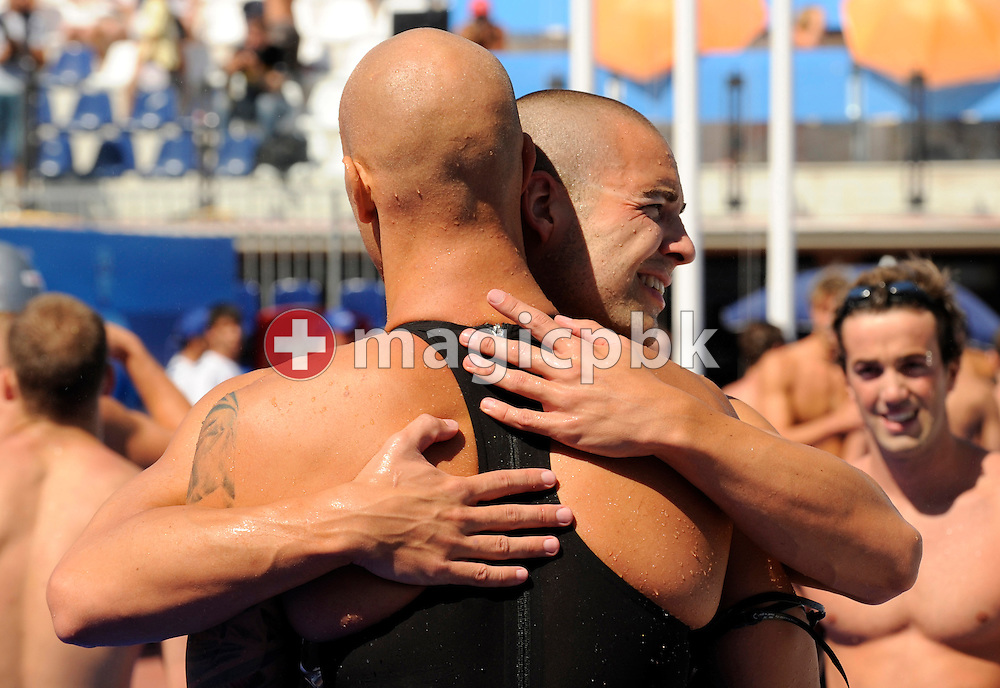Brent HAYDEN (L) of Canada hugs his teammate Joe BARTOCH after competing in the men's 4x100m medley relay preliminary at the 13th FINA World Championships at the Foro Italico complex in Rome, Italy, Sunday, Aug. 2, 2009. (Photo by Patrick B. Kraemer / MAGICPBK)