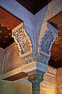 """Detailof the Arabesque Moorish architectural pillar capital in the Mexuar administrative rooms in the Palacios Nazaries. Alhambra, Granada, Andalusia, Spain. . The Alhambra is a palace and fortress complex located in Granada, Andalusia, Spain. It was originally constructed as a small fortress in 889 CE on the remains of ancient Roman fortifications. The Alhambra was renovated and rebuilt in the mid-13th century by the Arab Nasrid emir Mohammed ben Al-Ahmar of the Emirate of Granada, who built its current Alhambra palace and walls. The Alhambra was converted into a royal palace in 1333 by Yusuf I, Sultan of Granada. The decoration of The Alhambra consists for the upper part of the walls, as a rule, of Arabic inscriptions—mostly poems by Ibn Zamrak and others praising the palace—that are manipulated into geometrical patterns with vegetal background set onto an arabesque setting (""""Ataurique""""). Much of this ornament is carved stucco (plaster) rather than stone. Tile mosaics (""""alicatado"""") of The Alhambra, with complicated mathematical patterns (""""tracería"""", most precisely """"lacería""""), are largely used as panelling for the lower part. .<br /> <br /> Visit our SPAIN HISTORIC PLACXES PHOTO COLLECTIONS for more photos to download or buy as wall art prints https://funkystock.photoshelter.com/gallery-collection/Pictures-Images-of-Spain-Spanish-Historical-Archaeology-Sites-Museum-Antiquities/C0000EUVhLC3Nbgw <br /> .<br /> Visit our ISLAMIC HISTORICAL PLACES PHOTO COLLECTIONS for more photos to download or buy as wall art prints https://funkystock.photoshelter.com/gallery-collection/Islam-Islamic-Historic-Places-Architecture-Pictures-Images-of/C0000n7SGOHt9XWI"""