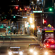Kansas City Main Street at night with streetcar