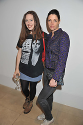 Left to right, ROSIE HOLLAND and MARY McCARTNEY at a private view of work by the late Rory McEwen - The Colours of Reality, held at the Shirley Sherwood Gallery, Kew Gardens, London on 20th May 2013.