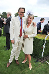 EARL & COUNTESS OF MARCH at the 3rd day of the 2011 Glorious Goodwood Racing Festival - Ladies Day at Goodwood Racecourse, West Sussex on 28th July 2011.