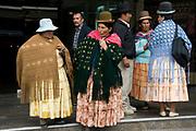 La Paz. Group of Aymara people waiting on the street.
