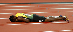 Jamaica's Usain Bolt lies injured after the Men's 4x100m Relay Final during day nine of the 2017 IAAF World Championships at the London Stadium. Picture date: Saturday August 12, 2017. See PA story ATHLETICS World. Photo credit should read: Martin Rickett/PA Wire. RESTRICTIONS: Editorial use only. No transmission of sound or moving images and no video simulation.